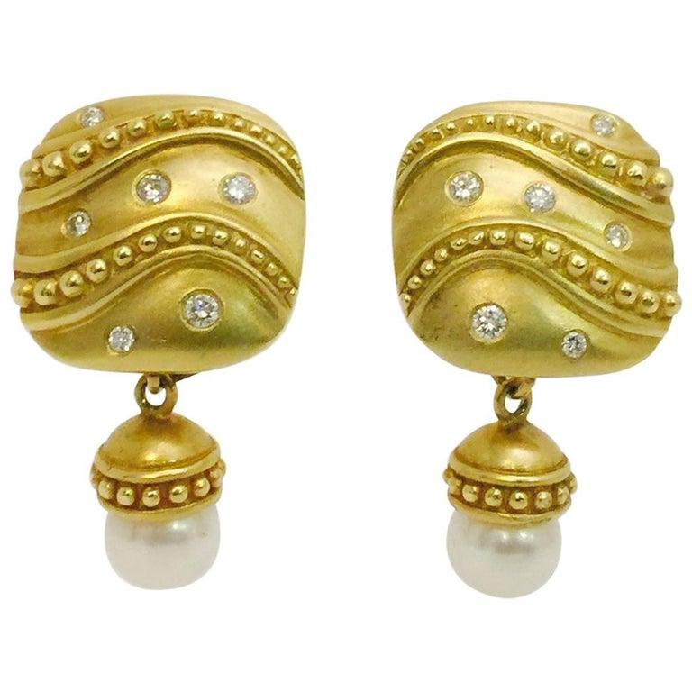 Elegant 18 Karat Diamond and Dangling Pearl Enhancer Earrings