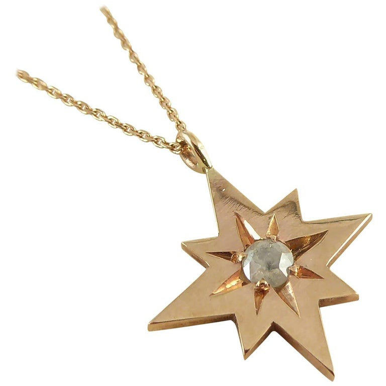 Modern, Pre-Owned Rose Cut Diamond Pendant in 9 Carat Rose Gold Star Setting For Sale