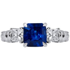 H & H 2.57 Carat Emerald Cut Blue Sapphire and Diamond Ring