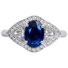 H & H 1.50 Carat Oval Royal Blue Sapphire and Trillion Cut Diamond Cocktail Ring