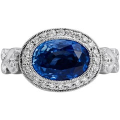 H & H 4.18 Carat Oval Sapphire and Diamond Pave Ring