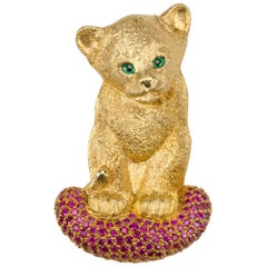 18 Carat Yellow Gold Lion Cub Brooch or Pendant with a Cushion of Rubies