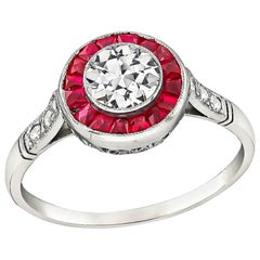 Charming 0.50 Carat Diamond Ruby Halo Ring