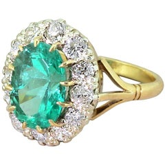 Midcentury 3.26 Carat Colombian Emerald and Diamond Cluster Ring, circa 1950