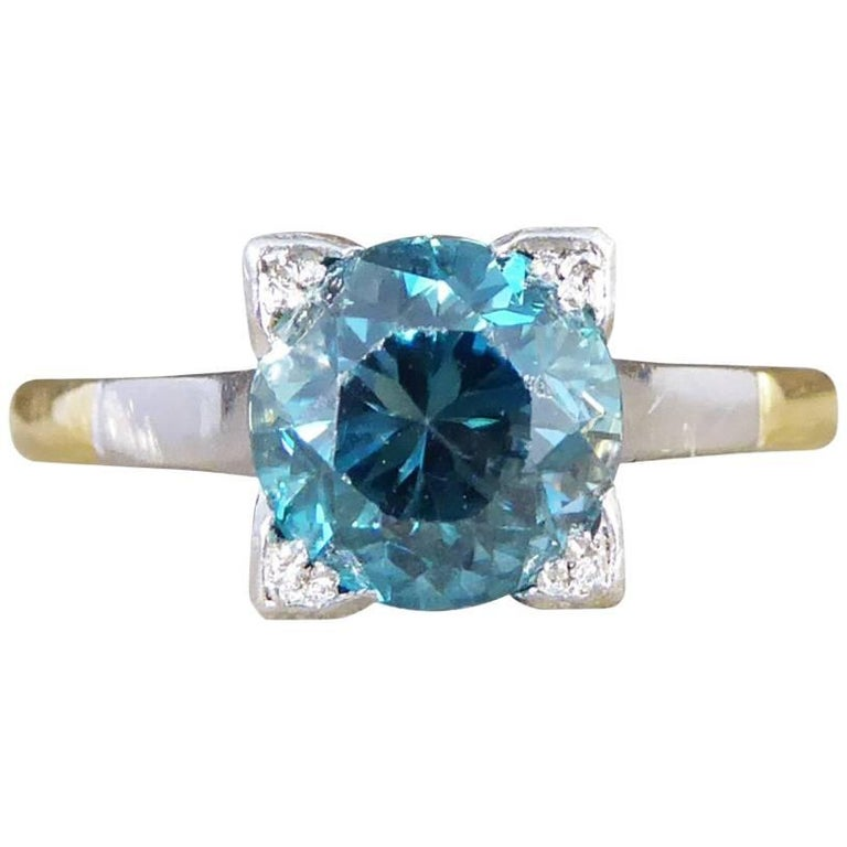 1.75 Carat Blue Zircon Art Deco Ring in 18 Carat Yellow Gold and Platinum For Sale