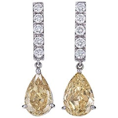 GIA Certified 4.04 Carat Pear Yellow Diamond White Gold Drop Earrings