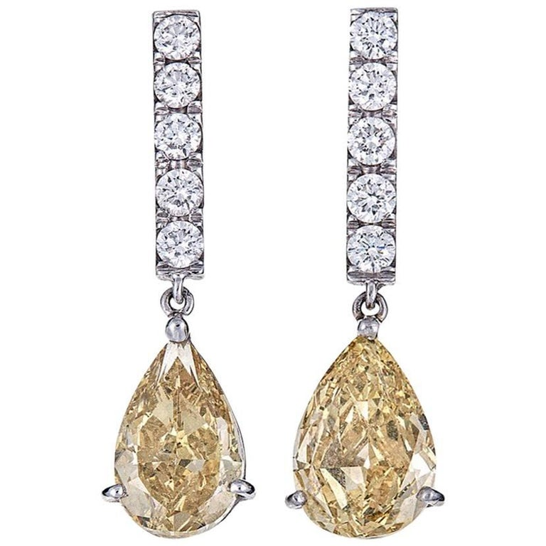 GIA Certified 4.04 Carat Pear Yellow Diamond White Gold Drop Earrings For Sale