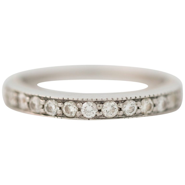 1990s 0.25 Carat Diamond and 14K Gold Eternity Band Ring