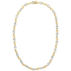 Alternating Floral Gold Leaf and Faceted Aquamarine Necklace