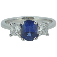 Sapphire and Diamond Engagement Ring in Traditional Style