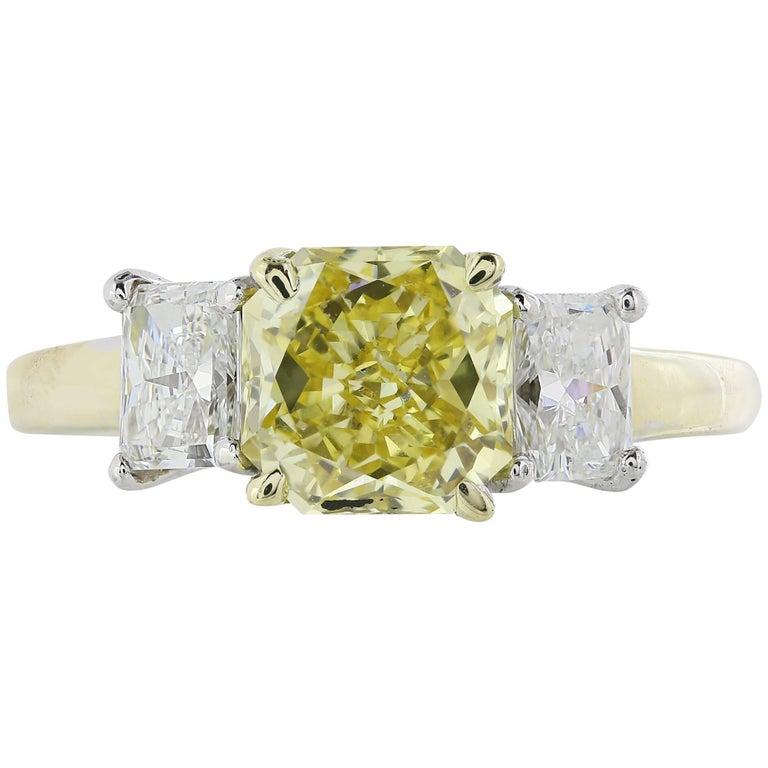 1.66 Carat Fancy Yellow Diamond Three-Stone Ring For Sale