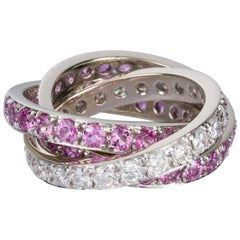 Pink Sapphire and 1.32 carat White Diamond Three-Band Ring