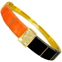 18 Karat Onyx, Coral and Diamond Bangle Bracelet