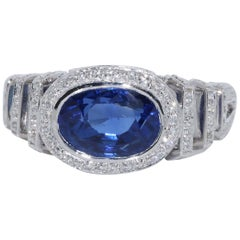 3.54 Carat Certified Burma No Heat Oval Sapphire and Diamond Ring