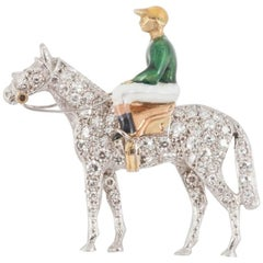 Racehorse and jockey brooch set diamonds and enamel silks,Alabaster and Wilson