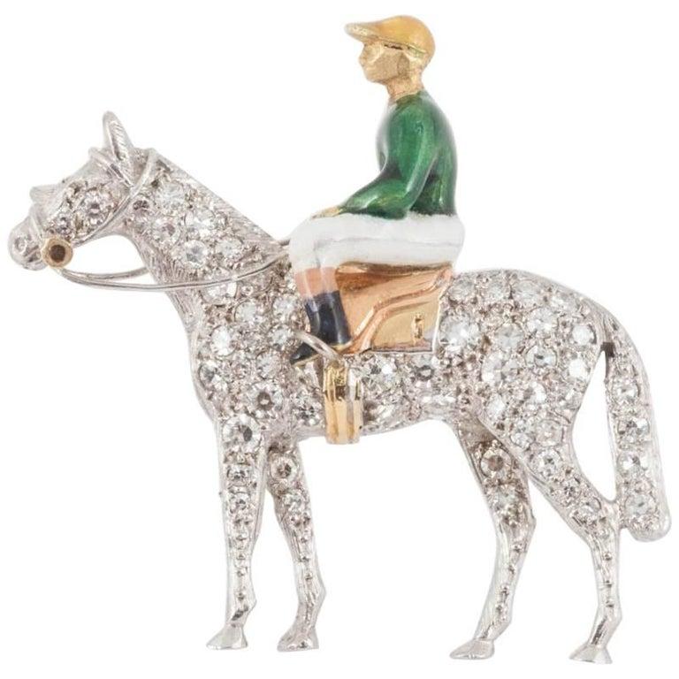 Racehorse and jockey brooch set diamonds and enamel silks,Alabaster and Wilson  1