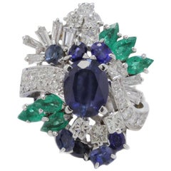 Contemporary White Gold, Diamonds, Emeralds and Blue Sapphires Cluster Ring
