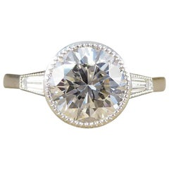 1.58 Carat Diamond Solitaire Ring with Tapered Baguette Shoulders in Plat