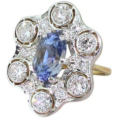 Retro 4.85 Carat Natural Ceylon Sapphire and 1.68 Carat Diamond Ring