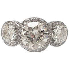 GIA Certified 2.88 Carat Round Diamond Platinum Three-Stone Ring