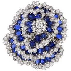 Van Cleef & Arpels 1960s Diamond Sapphire and Platinum 'Camilla' Brooch