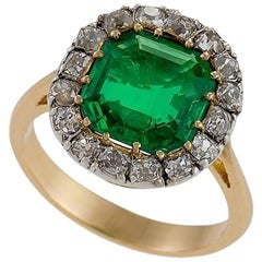 Edwardian Emerald Diamond Gold and Platinum Cluster Ring