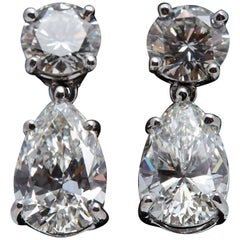 3.08 Carat Dangling GIA Pear Shaped Platinum Earrings with Two Round Diamonds