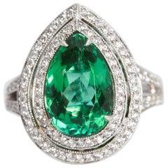 Pear Shaped Paraiba Tourmaline 3.50 Carat 18 Karat Halo Ring with Diamonds