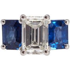 1.55 Carat GIA Emerald Cut Diamond Side Sapphires Platinum Three-Stone Ring