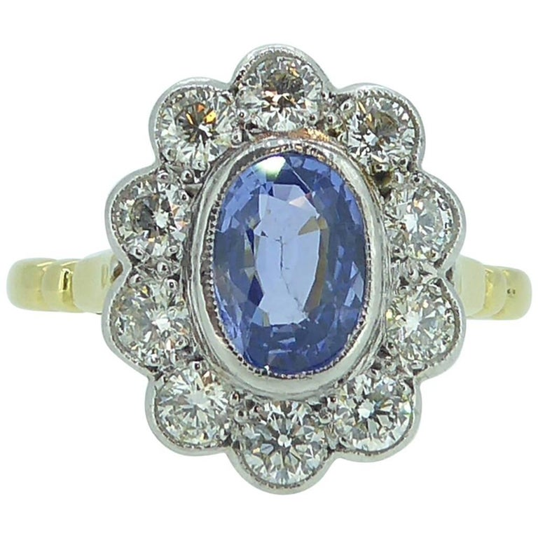 Vintage Sapphire and Diamond Engagement Ring, Cluster Style in 18 Carat Gold For Sale