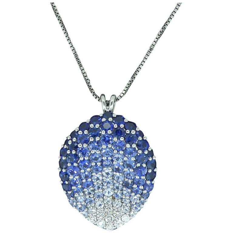 Contemporary Diamond, Blue Sapphire and White Sapphire Pendant For Sale