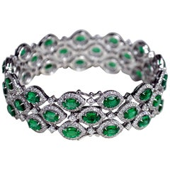 15.69 Carat Oval Zambian Emerald Diamond 18 Karat Gold Three-Row Bracelet