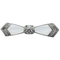 Marcus & Co. Art Deco Platinum Diamond and Carved Crystal Bow Pin