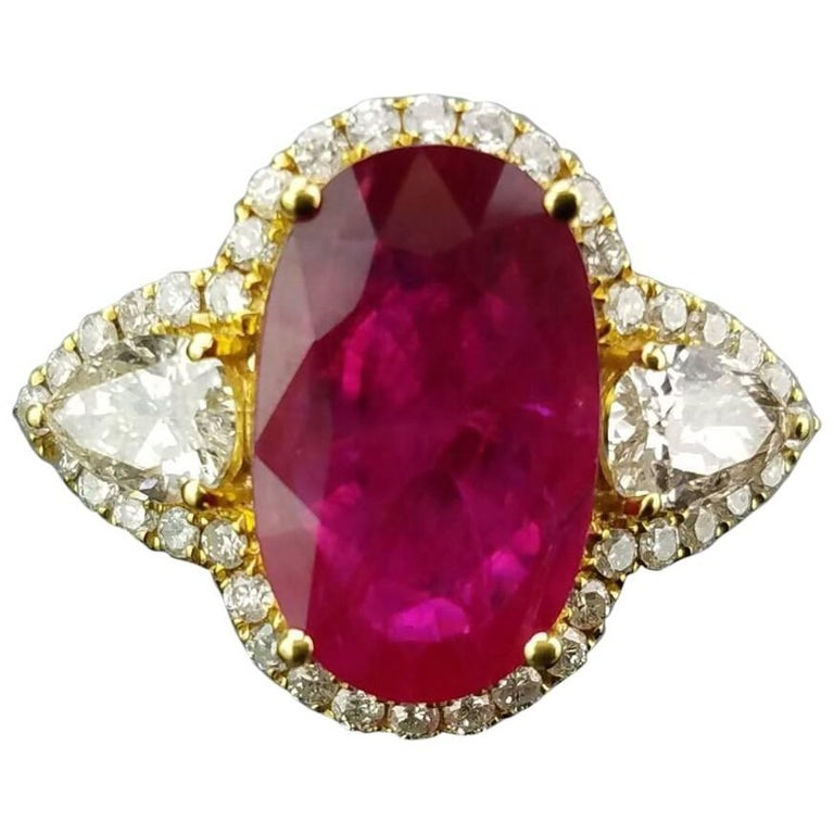 Oval Mozambique Ruby and Diamond 18 Karat Yellow Gold Cocktail Ring