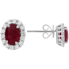 GIA Certified Oval Ruby Diamond Halo Earrings Offered by Marisa Perry Atelier