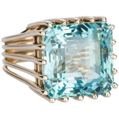 21 Carat Aquamarine 14 Karat Yellow Gold Cage Style Cocktail Ring