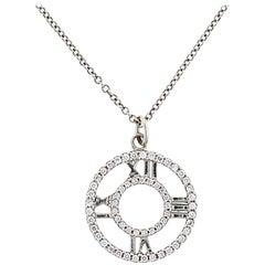 Tiffany & Co. 18 Karat Gold Atlas Diamond Roman Numeral Circle Pendant Necklace