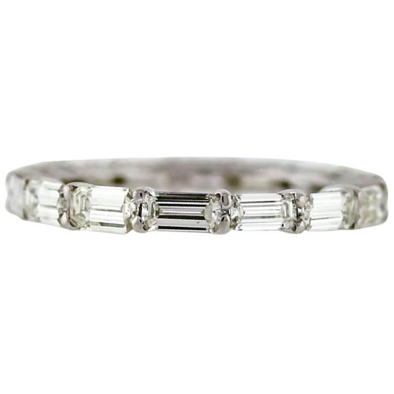 East to West Emerald Cut Diamond Eternity Band Made in Platinum For Sale