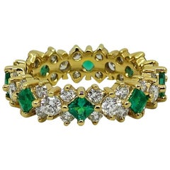 2.32 Carat Emerald and Diamond Eternity Yellow Gold Band