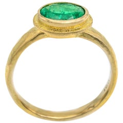 Oval Emerald Ring in 18 Karat Yellow Gold, Hammered and Textured, 0.90 Carat