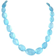 Decadent Jewels Carved Blue Topaz Gold Necklace