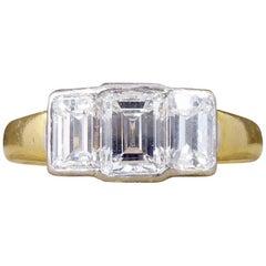 Modern Emerald Cut Diamond Three-Stone Engagement Ring in 18 Carat Gold