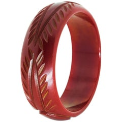 Art Deco Deep Cherry Red Hand-Carved Bakelite Bangle