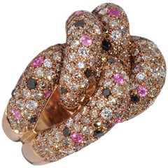 Black and White Diamonds with Pink Sapphires Yellow Gold Interlaced Ring
