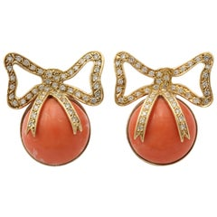 1960s Cabochon Angel Skin Coral and Diamonds Wrapped in a Bow Gold Earclips