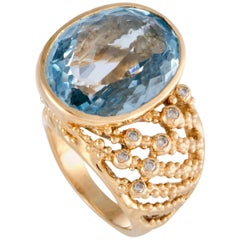 Diamond and Oval Topaz Yellow Gold Ring