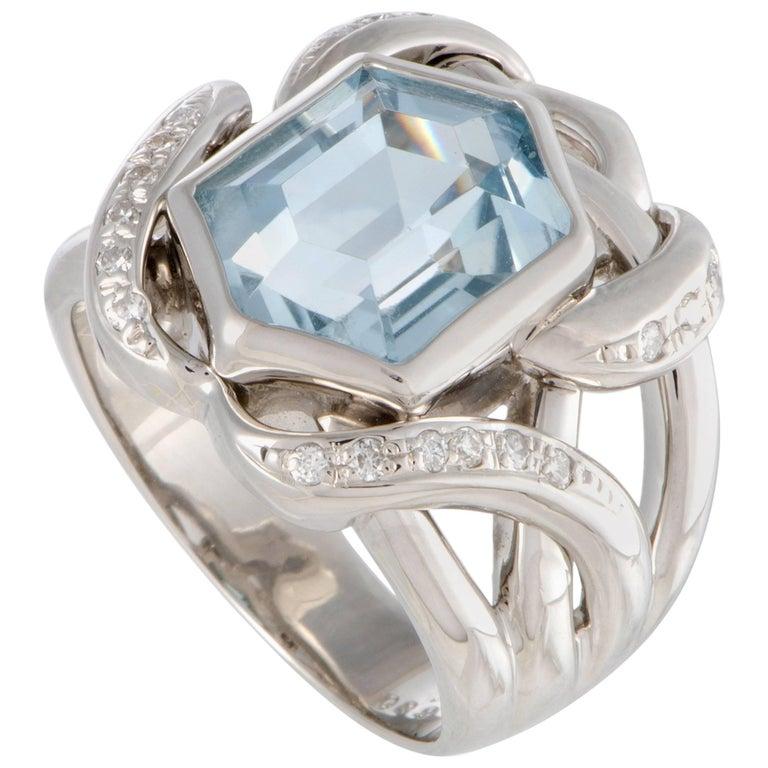 Knotted Diamond and Aquamarine Platinum Ring