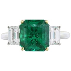 GIA Certified 3.31 Carat Emerald Diamond Three-Stone Ring