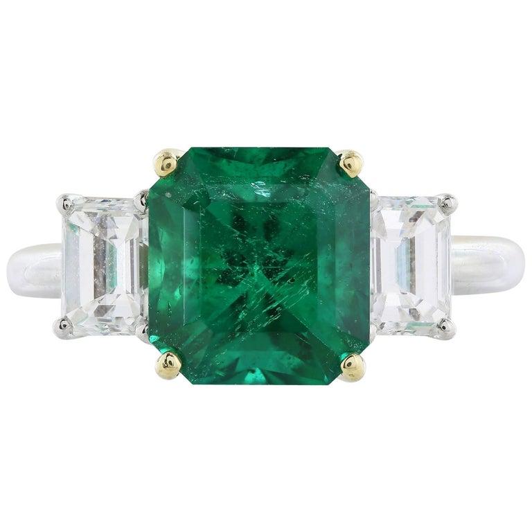 GIA Certified 3.31 Carat Emerald Diamond Three-Stone Ring