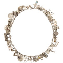 Fulsome Sterling Silver Charm Necklace, circa 1940s